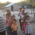The kids in Los Quiotes waiting in line to hit the piñata.
